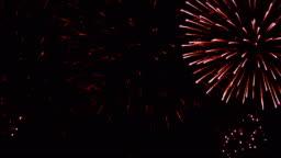 Firework display. New Year celebration fireworks. Christmas background. 4K UHD
