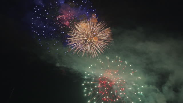 firework display on black background - 10 seconds or greater stock videos & royalty-free footage