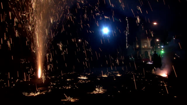 Firework fountain ejects sparks during Diwali Hindu Festival of Lights Available in HD.