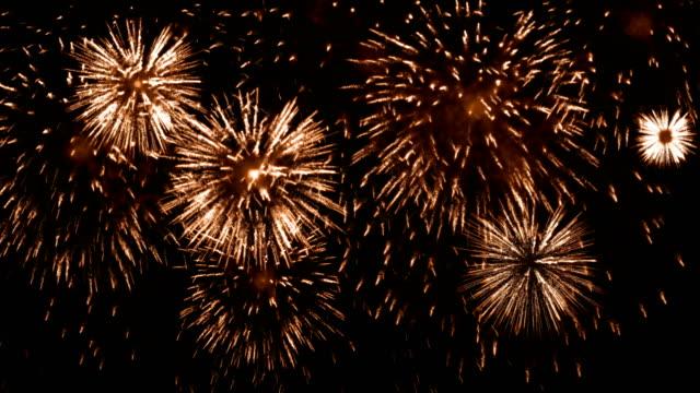 4k firework orange background - orange stock videos & royalty-free footage
