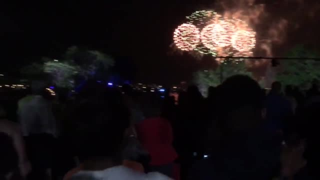 fireworks and spectators at boston fireworks on charles river - charles river stock videos & royalty-free footage