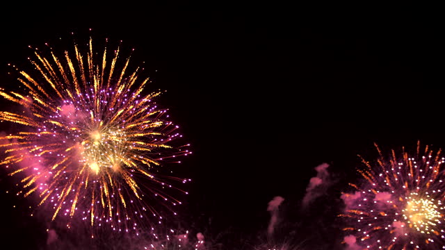 fireworks background - firework explosive material stock videos & royalty-free footage