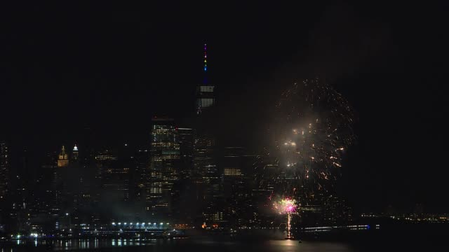 fireworks celebrating pride day light up the sky over the hudson river and skyline of new york city on june 28 2020 as seen from guttenberg new jersey - world trade center manhattan stock videos & royalty-free footage