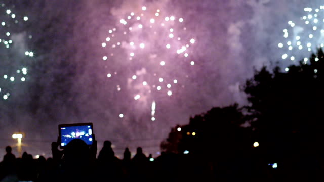 fireworks display and crowd of watchers - photographing stock videos and b-roll footage