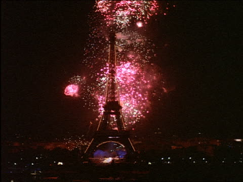 fireworks display behind eiffel tower / paris - eiffel tower stock videos and b-roll footage