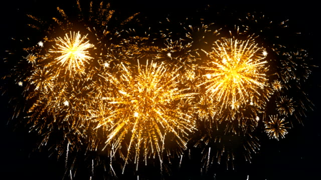 fireworks display gold color - gold colored stock videos & royalty-free footage