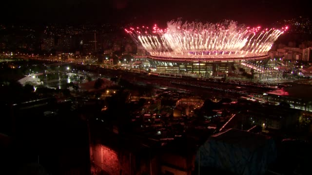 Fireworks display marks the end of the Rio de Janeiro 2016 Olympic Games at Maracana Stadium viewed form Mangueira favela on August 21 2016 in Rio de...