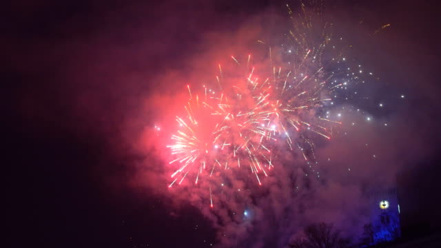 fireworks display on a night sky - pyrotechnic effects stock videos & royalty-free footage