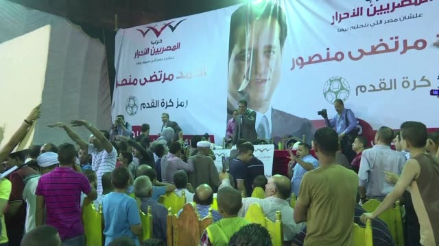 vídeos y material grabado en eventos de stock de fireworks erupt at his rallies his face is plastered across the streets of his cairo constituency and children wear t shirts printed with his image... - distrito electoral