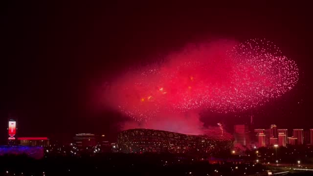 fireworks explode above the national stadium during an art performance titled 'the great journey' in celebration of the 100th anniversary of the... - firework display stock videos & royalty-free footage