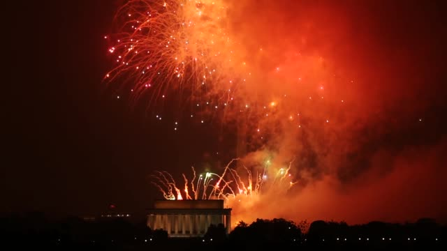 fireworks explode over the national mall to mark the united states' independence day july 4 2015 in washington dc the pyrotechnic display celebrated... - fourth of july stock videos & royalty-free footage