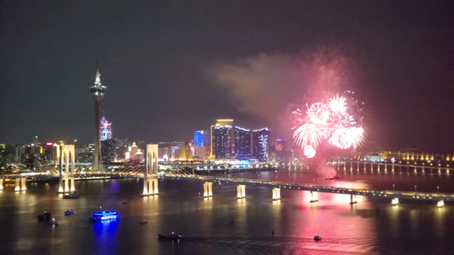 fireworks explode over the sea area in front of macau tower during the opening of the 30th macao international fireworks display contest on september... - macao stock videos & royalty-free footage