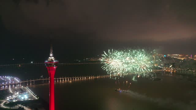 fireworks explode over the sky of macau to mark the national day on october 1, 2020 in macau, china. - macao stock videos & royalty-free footage