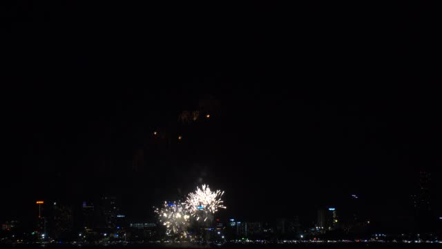fireworks explored over cityscape at night.holiday and celebration background - pattaya stock videos & royalty-free footage