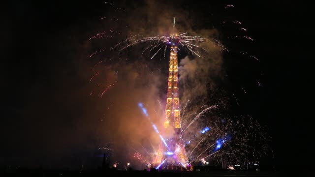 fireworks illuminate the eiffel tower during bastille day celebrations late tuesday on july 8 2020 in paris france this year due to covid19 outbreak... - pyrotechnic effects stock videos & royalty-free footage