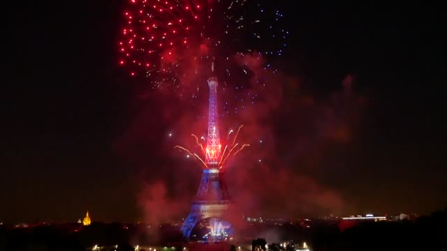 fireworks illuminate the sky around the eiffel tower as part of the bastille day celebrations in paris france on july 14 2017 - bastille paris stock videos & royalty-free footage