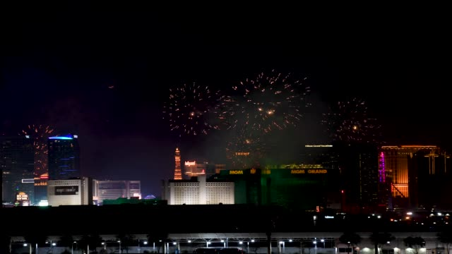 fireworks illuminate the skyline over the las vegas strip during an 8-minute-long pyrotechnics show put on by fireworks by grucci titled 'america's... - 年越し点の映像素材/bロール
