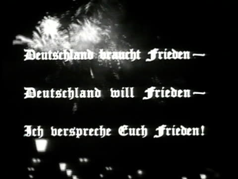 fireworks in night sky. 'germany needs peace germany wants peace i promise you peace' in german superimposed on night sky w/ vo translating. - 1939 stock-videos und b-roll-filmmaterial