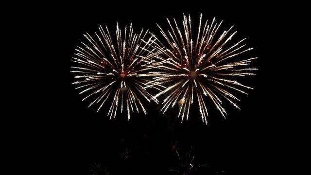 4k fireworks in night sky - firework display stock videos & royalty-free footage