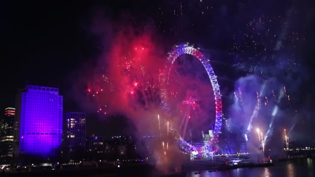 fireworks light up the sky above the london eye during the new year celebrations in london united kingdom on january 01 2020 - big wheel stock videos & royalty-free footage