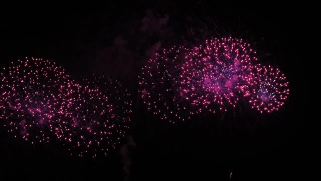 fireworks light up the sky,fireworks display on dark sky background.new year celebration.celebration - downsizing stock videos & royalty-free footage