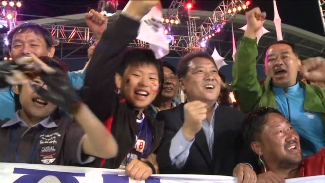 fireworks light up the south korean alpine resort of pyeongchang as jubilant residents celebrate victory in their third attempt to host the winter... - südkorea stock-videos und b-roll-filmmaterial