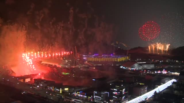 fireworks mark the opening of pyeongchang winter olympics in freezing temperatures and a spirit of rapprochement after the arrival of the highest... - opening ceremony stock videos & royalty-free footage