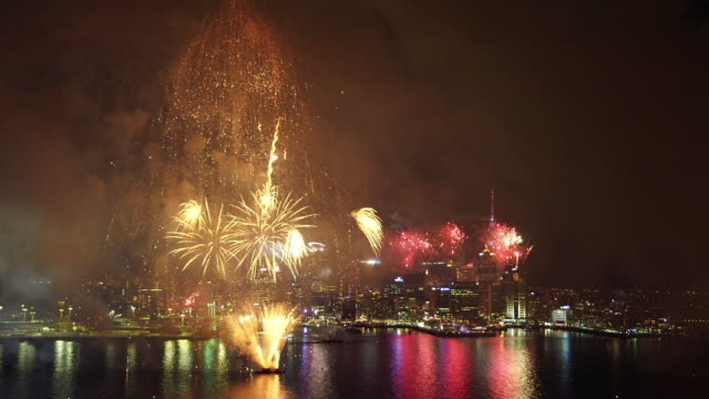 fireworks over city scape - waterfront stock videos & royalty-free footage