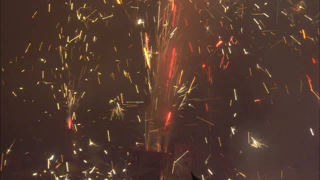 Fireworks shoot out sparks at a Chinese New Year celebration.