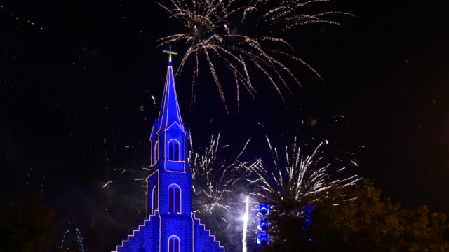 fireworks show behind the mother church in gramado, rio grande do sul - new year's eve - clock tower stock videos & royalty-free footage