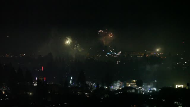 vídeos de stock, filmes e b-roll de fireworks that illuminated the settlement of the city of berastagi were seen in the air in karo during the new year celebrations on january 1... - dia do ano novo