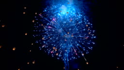 SLO MO Fireworks with Floating Chinese Sky lanterns Yee Peng Festival, Loy Kra thong in Chiang mai, Thailand