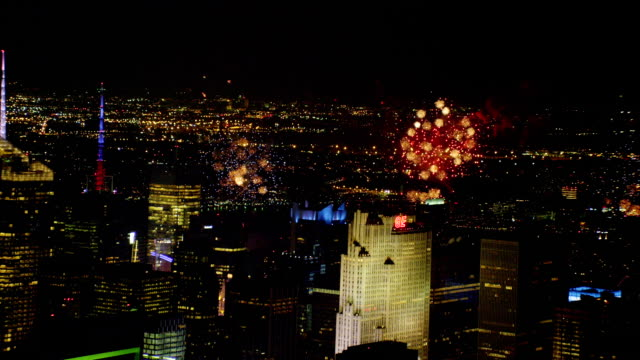 aerial fireworks with midtown manhattan in foreground at night - ロックフェラーセンター点の映像素材/bロール