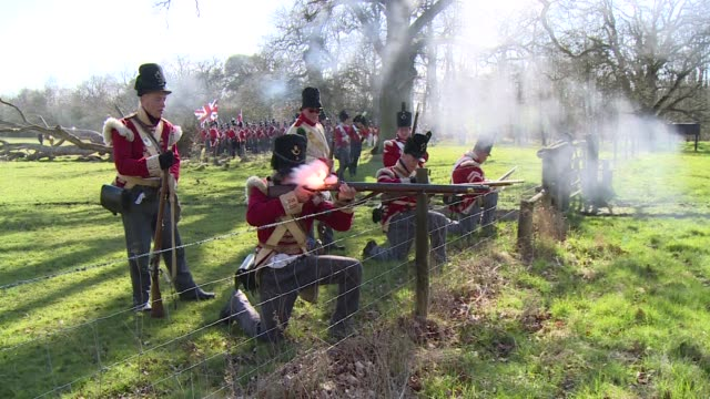 firing their weapons marching through the fields and bringing history to life two hundred years after the battle of waterloo enthusiasts prepare for... - historiskt återskapande bildbanksvideor och videomaterial från bakom kulisserna