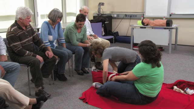 hd: first aid instructor immobilizing leg - comminuted fracture stock videos and b-roll footage