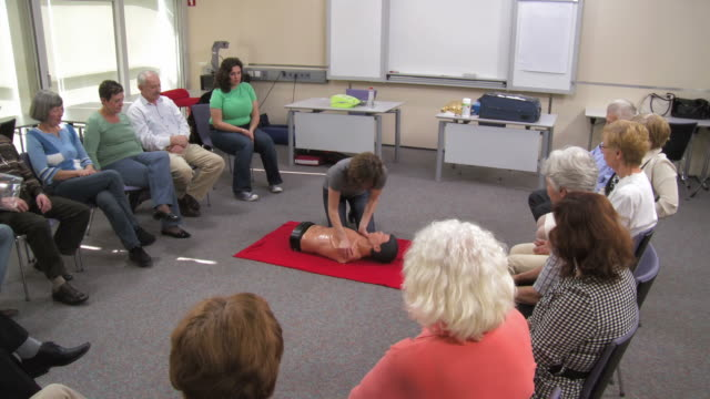 hd: first aid instructor showing artificial respiration - cpr stock videos & royalty-free footage