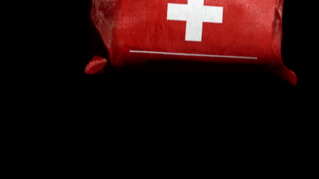 first aid kit falling on black background - first aid kit stock videos & royalty-free footage