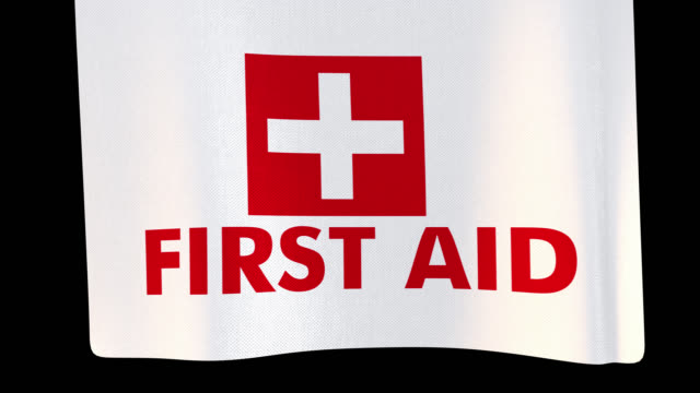 first aid unfolding cloth sign. alpha channel will be included when downloading the 4k apple prores 4444 file only - first aid kit stock videos & royalty-free footage