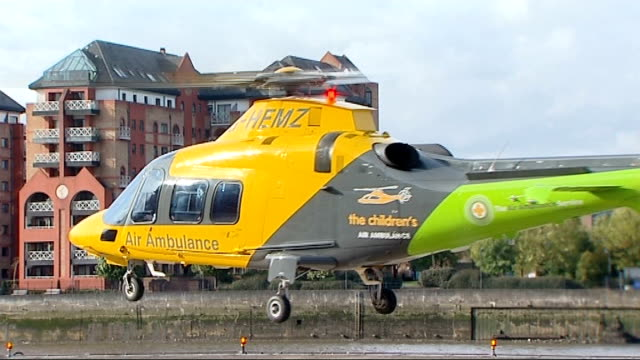first air ambulance for children launched england london battersea ext children's air ambulance taking off - バタシー点の映像素材/bロール