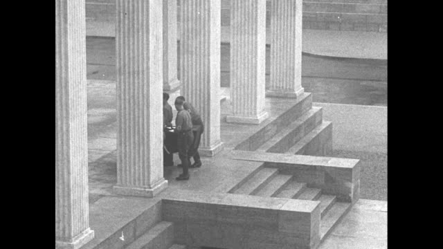 first anniversary of beer hall putsch / funeral procession with flagdraped coffin vaults being carried up glyptothek stairs by brown shirt... - braun stock-videos und b-roll-filmmaterial