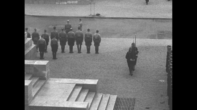 first anniversary of beer hall putsch / goose stepping soldiers march through crowdlined konigsplatz in munich during observation of first... - nazi brown shirts stock videos & royalty-free footage