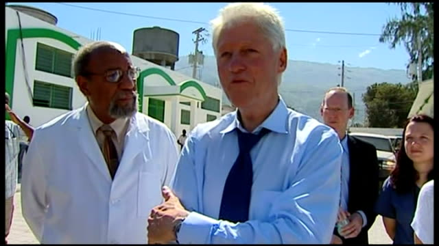 first anniversary of earthquake bill clinton speaking to press sot to come back here and see all this work going on is very hopeful but i still... - hispaniola stock videos & royalty-free footage