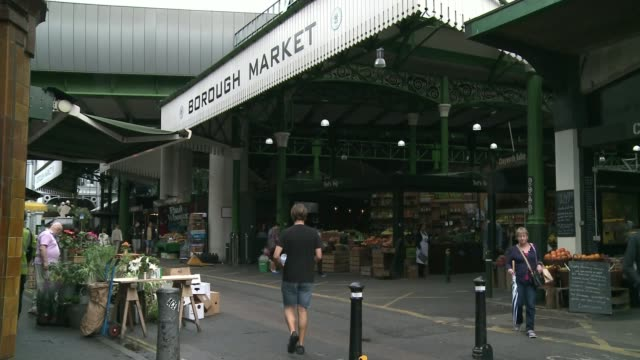 First anniversary of London Bridge attack Borough Market trader experiences T14061743 / TX Person along towards entrance People at reopening ceremony