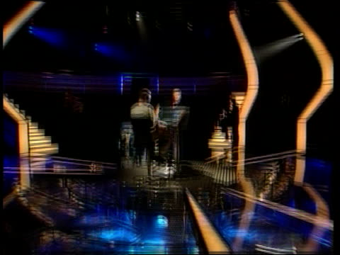 vídeos de stock, filmes e b-roll de first british quiz show millionaire created; lib ???: int chris tarrant rehearsing edition of 'who wants to be a millionaire?' - game show