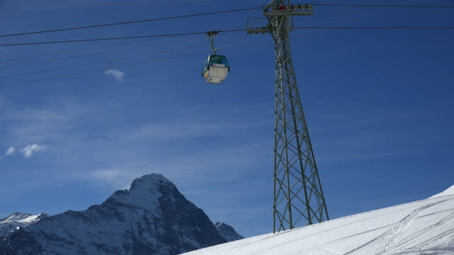 stockvideo's en b-roll-footage met first cable car and eiger, grindelwald, bernese alps, switzerland, europe - kabelwagen