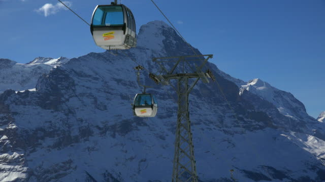 stockvideo's en b-roll-footage met first cable car and mount eiger, grindelwald, bernese oberland, canton of bern, switzerland - kabelwagen