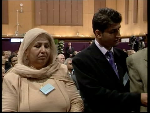 first citizenship ceremony for immigrants; itv evening news: helen wright england: london: int side immigrants standing in line at citizenship... - itv evening news stock-videos und b-roll-filmmaterial