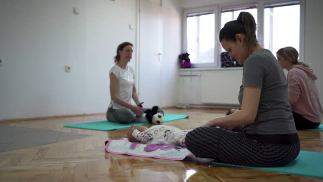 first class of yoga, for the newborn babies - 25 29 years stock videos & royalty-free footage