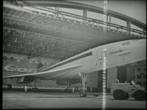 B/W 1969 first Concorde plane being towed out of airplane hangar in France