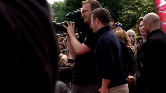 first day of auditions for new 'x factor' television series at birmingham nec long shot of dermot o'leary greeting fans on red carpet then speaking... - jumpsuit stock videos and b-roll footage